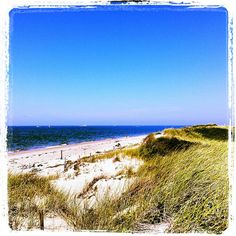 Herring Cove Beach in Provincetown, MA is one of the favorite destinations with Provincetown visitors.  Enjoy the warm waters of the bay in the morning and afternoon and a picturesque view as the sun goes down. #capecod #newengland #travel #ptown