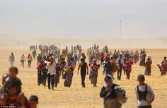Exodus: Yazidis flee to safety helped by Kurdish fighters. Fighters from IS are also accused of kidnapping 300 women to use for sex or as domestic slaves