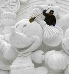 mickey mouse gets a brush up at the sapporo snow festival.