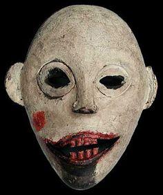 Indai-Guru mask, Iban Dayak  Like Steve Bell's caricature of Tony Blair