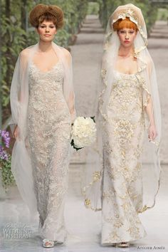 A2011 wedding dresses, brides on runway wearing veils as they model bridal gowns made in Italy by Atelier Aimee