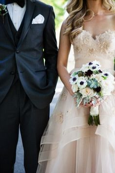 Love the idea of a wedding dress that has some color to it or even off-white!