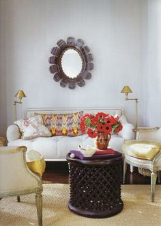 Jeff Bilhuber room. Like ikat pillow and table but especially that mirror.