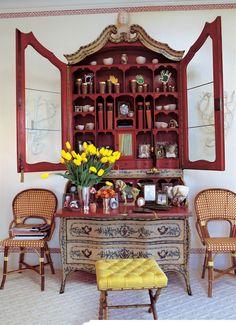 Beautiful secretary, yellow tufted stool, yellow flowers - Jeffrey Bilhuber