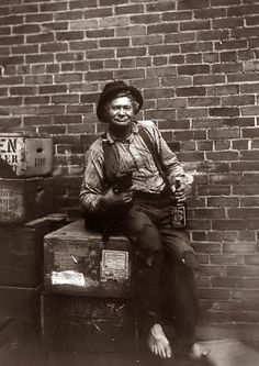 Hobo in an alley, with a bottle of whiskey 1907