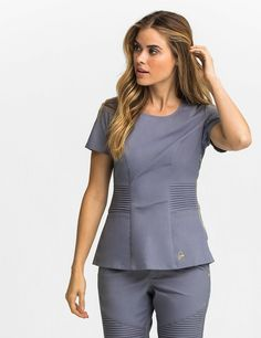 The Pintuck Top in Graphite is a contemporary addition to women's medical scrub outfits. Shop Jaanuu for scrubs, lab coats and other medical apparel.