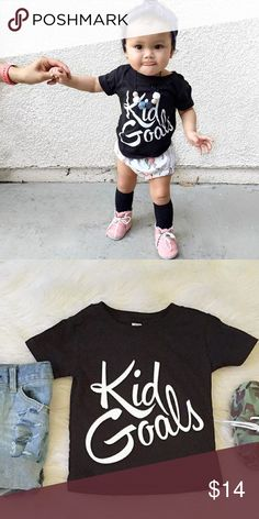 "Kid Goals Tee Black t-shirt with white font reads ""Kid Goals"". Excellent condition. // No trades. Ships daily Mon to Fri. ""Add to Bundle"" items from my Kids and Women's to Save! Xo, Instagram @dasrozo for mommy and me fashion. Shirts & Tops Tees - Short Sleeve"