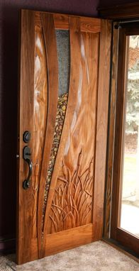 Walnut Entry Door $9,800+ / Ships in 5 weeks  Hand carved entry door. Made with walnut, river rock and glass