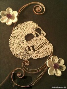 Sharee Surrett from Hampton, VA shared with us a quilled skull that she created.      Wound-up C says:   Since the Skullmaster posted his 31...