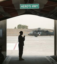 """This is a photo of Sgt. Jennifer Wilson, NCO in charge of the Casualty Liaison Team at Joint Base Balad, Iraq, the main air base in that country. She is standing at a location called """"Hero's Highway."""" Each patient brought by helicopter to the Air Force Theater Hospital here passes through Hero's Highway. She said, """"I talk to them, thanking them for what they have done, telling them they are a hero, they will never be forgotten. I am far from an angel. I just do what is in my heart."""""""