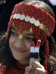 Yemeny girl wearing a traditional costume  flashes the victory sign!