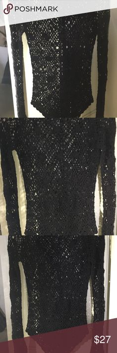 Beautiful crochet knit black sweater Thick enough to look cool with just black bra underneath . Or dress it upI..It is fairly fitted so it only calls for something sheet or very light under Sweaters