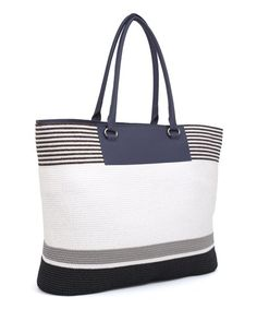 Toss in a suit and shades and head out for a weekend getaway! With a roomy design and sturdy construction, this striped tote will transport the essentials in style.