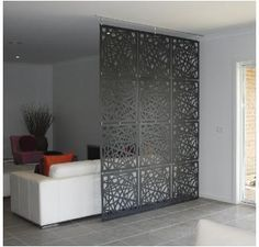 grid screen/ bedroom divider. Might do something like this to create separation between kitchen and living room