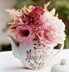 vintage teapots with flowers in them are perfect for bridal shower