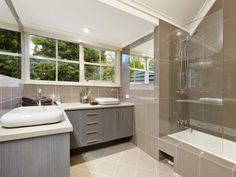 Check Out Modern Bathroom Design For Your Home. Modern bathrooms create a simplistic and clean feeling. In order to design your modern bathroom make sure to utilize geometric shapes and patterns, clean lines, minimal colors and mid-century furniture. Toilet And Bathroom Design, Rustic Bathroom Wall Decor, Rustic Bathrooms, Modern Bathroom Design, Bathroom Interior Design, Bathroom Furniture, Bathroom Ideas, Bathroom Designs, Shower Ideas