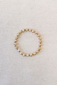 Single-strand elastic bracelet made from recycled paper beads. Stack them and mix-and-match them. Each piece is handmade by women in Uganda. Daphne Bracelet Gold by 31 Bits. Accessories - Jewelry - Bracelets Alabama