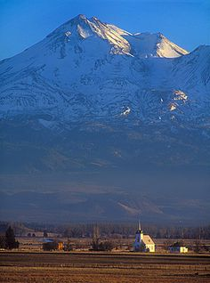 Snow-covered Mount Shasta looms over Little Shasta Church.
