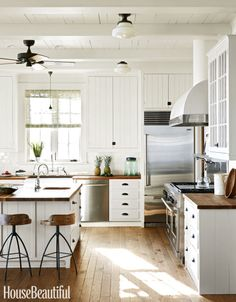 Pale oak floors have a scrubbed look, and plank cabinetry with painted hinges and black latches give this Florida kitchen old-time charm. To top the counters and island, the architect and homeowner chose butcher block for its warmth and informality. Click through for more kitchen design and decorating ideas.