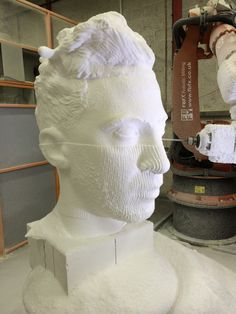 'Fudge' emerging from a block of polystyrene being sculpted by our Robot. This was a promotional sculpt for the band 'Fudge and the Frequency'