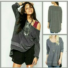 Free People Gray Tunic An oversized Free People pullover with heavy fading for a well-loved look. Side slits accentuate the relaxed fit. Patch front pockets sit above the raw asymmetrical hem. Ribbed neckline. Long sleeves and raw cuffs. NWT. Free People Sweaters