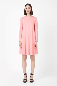 Based on the shape of a sweatshirt, this melange dress is made from extra soft jersey with a clean raw-cut edges. A loose A-line shape, this relaxed style has fitted long sleeves and a sporty ribbed neckline.