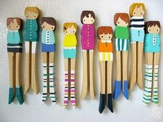 wood peg people with hand knit socks, by mooshoopork