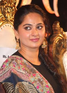 Tollywood Golden Queen Anushka Shetty Face Close up Smiling Stills In Black Dress