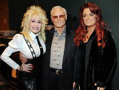 Loretta Lynn, Merle Haggard and other living legends of country music are taking George Jones' death hard, an unsurprising reaction to the loss of an artist who many, including Dolly Parton, call the finest singer of all time. Country Music Playlist, Country Music Lyrics, Country Music Videos, Country Music Artists, Country Music Stars, Country Songs, Music Festival Outfits, George Jones, Music Album Covers