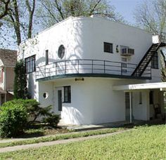 Tulsa, Oklahoma - the  Whenthoff Residence at 1142 South College Avenue was built in 1935.   This house was designed in the streamlined ship style with two-stories of brick laid over tile blocks and painted to look like stucco. A second story balcony serves as a canopy for the entry and wraps around the house. Its triple railing creates the illusion of a ship's bridge.