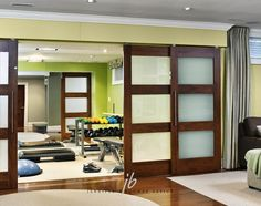 exercise room with sliding doors to office/craft room! -this is going where Andrew thinks his man cave is going!