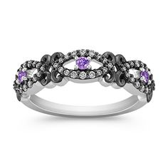 Make a statement with a bold ring. This one has lavender sapphires, diamonds, and black ruthenium on white gold.
