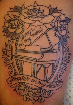 Piano and filigree frame tattoo - Ebony Mellowship (different quote if any at all).
