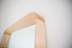 SIMPLE MIRROR by Kalon Studios. Solid Ash mirror with chamfered edge. Making use of simple woodworking techniques, the Simple Collection offers purity of material, form and function. The pared back collection creates a tranquil space of simple and unobtrusive beauty. Sustainably made in the USA.