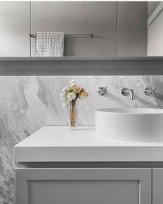 A close-up of the tranquil grey tones through this natural marble beauty. Our is a gem 💫 - Stone: Natural marble, Elba Honed Wall tiles: Tapware: Joinery colour: Two Pack Dulux Dieskau Simple Bathroom Designs, Bathroom Ideas, Shaker Doors, Grey Doors, Tiny Bathrooms, Kitchen Showroom, St Kilda, Splashback, Painted Floors