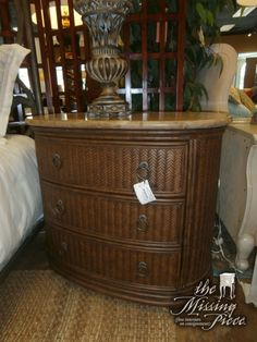 Lexington woven rattan accent chest with stone top by Henry Link. Measures 36 x 22 x 33. Two available at time of posting.
