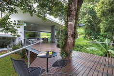 Cañas Arquitectos in San Antonio de Escazú, Costa Rica, built a wood deck on steel posts around a ficus tree that has been on the property for years.