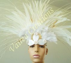 Love the feather arrangement. That mannequin head though....
