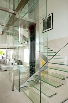 transparent glass stairs to the second floor