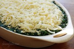 Makeover Spinach Gratin: Creamy spinach with a hint of nutmeg is baked in the oven topped with melted cheese for guiltless decadent side dish.