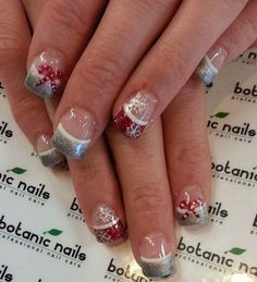 Christmas French tips. Draw the holiday season on your French tips with red and silver glitter polish at the tips, lined with white polish. You can also draw different colored ribbons as well as snowflakes on top.