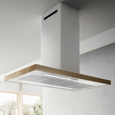 Bio is the new Elica hood that maintains traditional lines while being, at the same time, innovative. Satin white paired with natural wood, allows for great versatility, making it go together with any space.