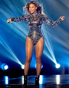 Beyonce performs onstage during the 2014 MTV Video Music Awards at The Forum on August 24, 2014 in Inglewood, California. Bodysuit by Tom Ford.