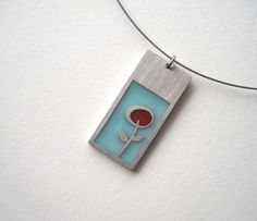 Flower Bud Necklace by Kathleen Dautel of Spark Metal Studios, stainless steel with resin on stainless steel cable. Available at Green Hill Center for NC Art for $80, info@greenhillcenter.org or come by!