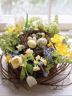 grapevine wreath, loosen a bit, tuck in the beautiful flowers, add eggs maybe a ribbon. Pretty centerpiece
