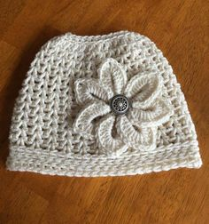 Super proud of my messy bun! A week ago someone inspired me with a picture of their beanie. I used the Easy Peasy pattern and the Crocodile flower on Ravelry.