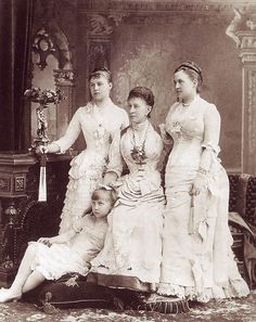 Queen Olga of Greece (right) with her daughters Princesses Alexandra (standing) and Marie and her mother Grand Duchess Alexandra Iosifovna (center)    Olga was born a Grand Duchess of Russia, a granddaughter of Nicholas I. Later, both of her daughters married back into the Romanov family.