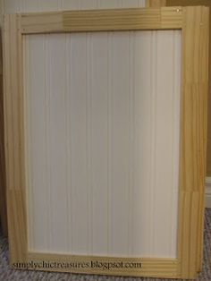 Adding trim and wallpaper to laminate cabinets..