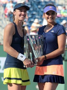 Martina Hingis, of Switzerland, and Sania Mirza, of India pared up to win the prestigious Premier Indian Wells event in southern CA. Nicely done ladies : )