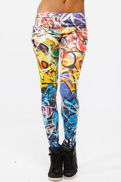27e0856851ab8 Check out the street art inspired leggings with a slick combination of  color! It features